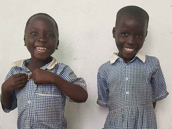 Brenda and Sam, children put in school by our sponsorship program